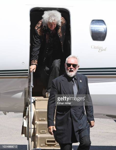 Guitarist Brian May and drummer Roger Taylor of Queen Adam Lambert get off a jet as they arrive at the MGM Resorts aviation hangar to kick off the...