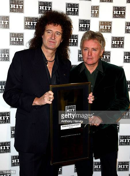 Guitarist Brian May and drummer Roger Taylor of Queen receive an award for the best hit single of all time as voted for by the Guiness Book of...