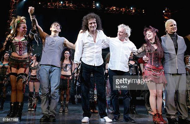 Guitarist Brian May and drummer Roger Taylor of the band Queen join cast members during the 1000th performance of Ben Elton's musical We Will Rock...