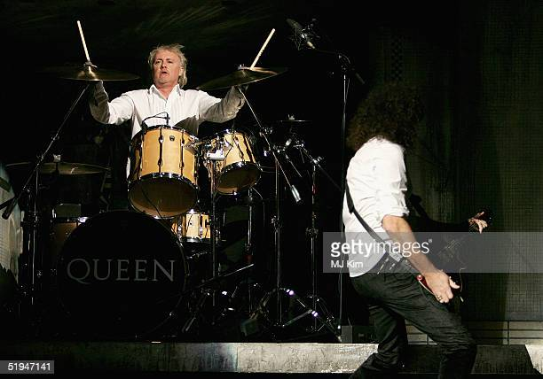 Guitarist Brian May and drummer Roger Taylor of the band Queen perform onstage during the 1000th performance of Ben Elton's musical We Will Rock You...