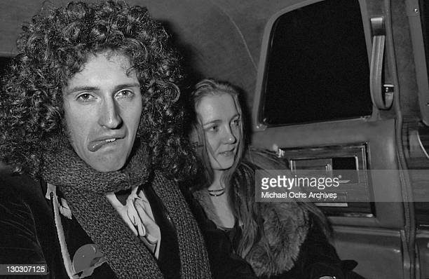 Guitarist Brian May of British rock band Queen with his wife Chrissie nee Mullen circa 1977