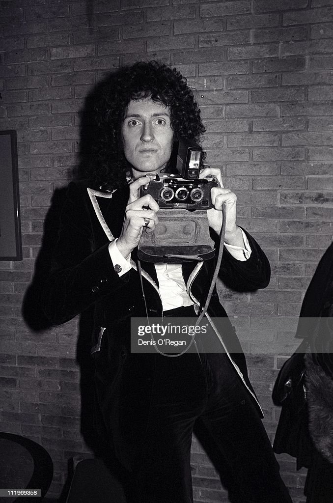Guitarist Brian May, of British rock group Queen, backstage with a stereoscopic camera, 1977.