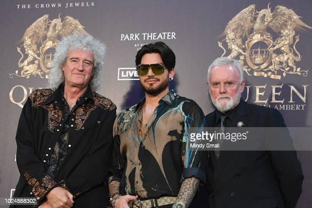 Guitarist Brian May singer Adam Lambert and drummer Roger Taylor of Queen Adam Lambert pose at the MGM Resorts aviation hangar to kick off the...