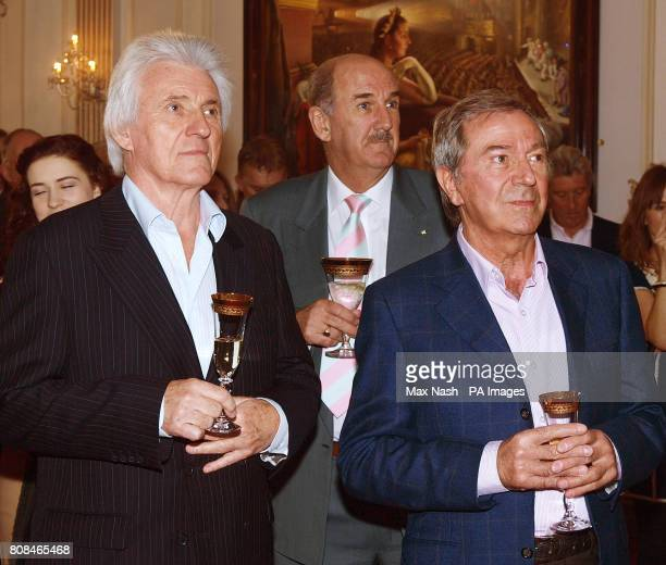 Guitarist Bruce Welch left Russ Abbot and Des O'Connor watch the unveiling of a plaque to commemorate the centenary of the London Palladium theatre