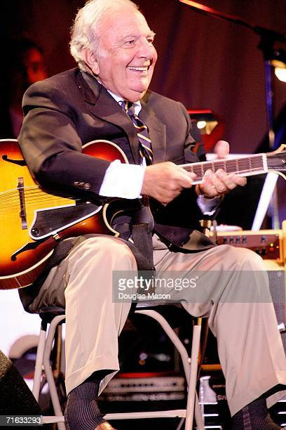 Guitarist Bucky Pizzarelli performs with his son John Pizzarelli during the first evening of the JVC Newport Jazz Festival at the Tennis Hall of Fame...