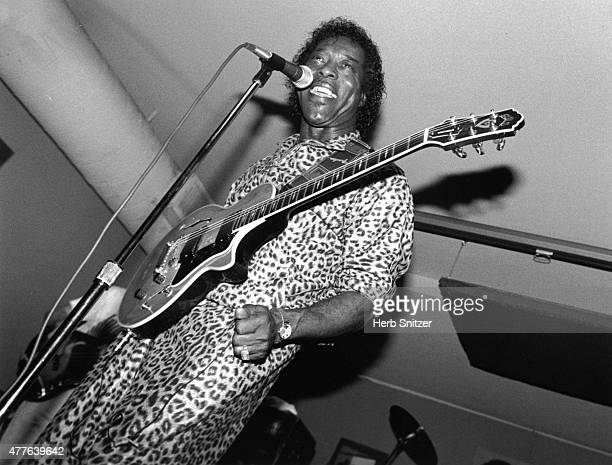 Guitarist Buddy Guy performs onstage at a blues club in 1990 in Chicago Illinois