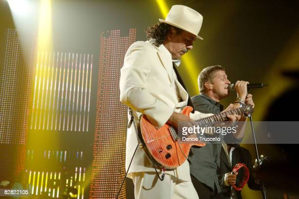 Guitarist Carlos Santana and musician Rob Thomas of Matchbox 20 perform inside The Andre Agassi 12th Annual Grand Slam for Children at The MGM Grand...