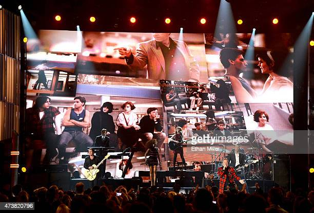 Guitarist Charlie Burchill singer James Kerr and bassist Ged Grimes of Simple Minds perform onstage during the 2015 Billboard Music Awards at MGM...