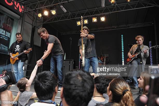 Guitarist Chris Henderson vocalist Brad Arnold bassist Greg Upchurch and guitarist Matt Roberts of 3 Doors Down perform on 'FOX and Friends' outside...