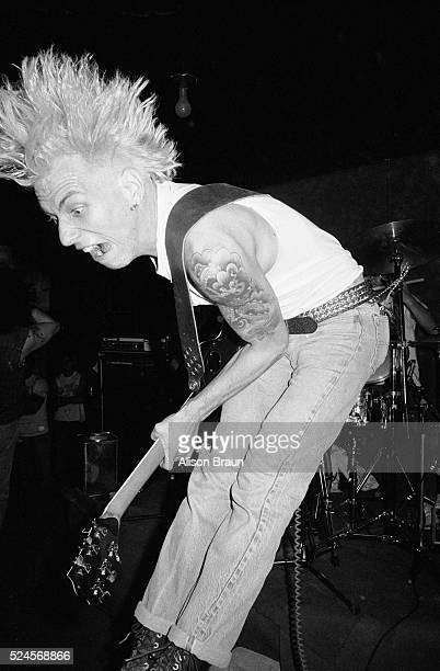 Guitarist Chris Smith of the punk band Battalion of Saints jumps and screams during a concert in Los Angeles