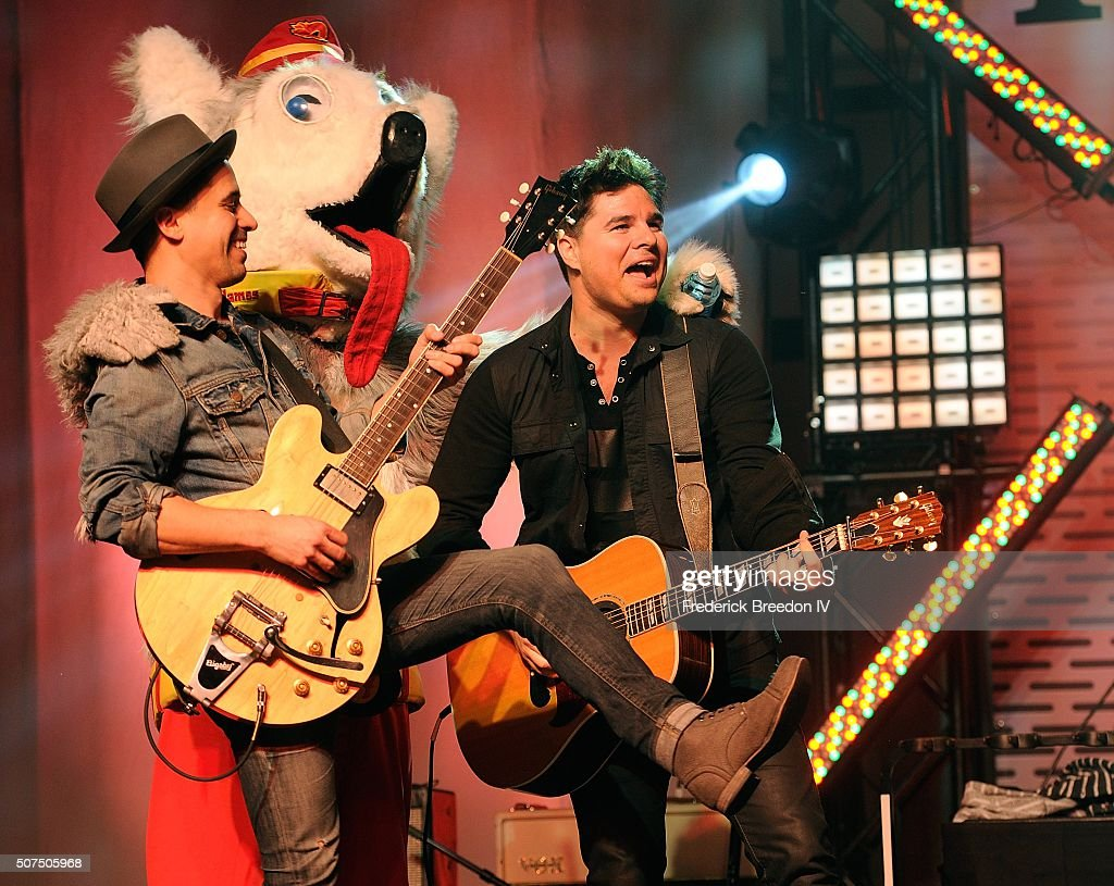 Guitarist Corey Congilio and Steven Lee Olsen are joined on stage by Calgary Flames mascot Harvey the Hound during a performance on the Honda Stage at the NHL Fan Fair presented by Bridgestone at the Music City Center,on January 29, 2016 in Nashville, Tennessee.