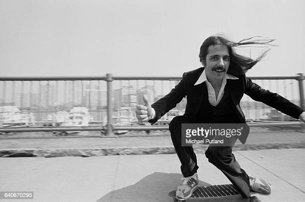 Guitarist Craig Chaquico of American rock group Jefferson Starship skateboarding in New York USA September 1978