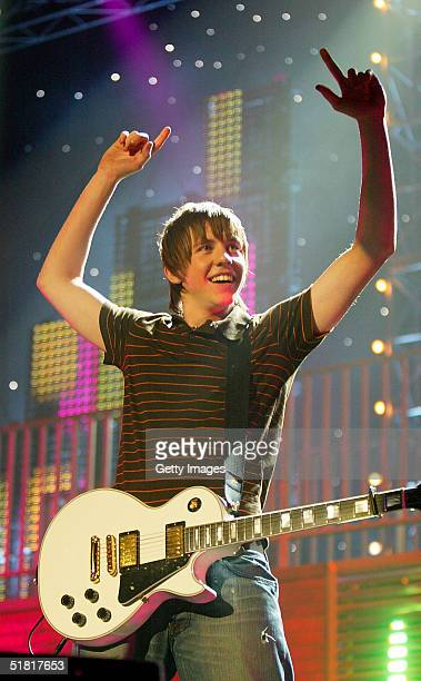 Guitarist Danny Jones of the band McFly performs at Christmas In Popworld at Wembley Arena on December 2 2004 in London Acts including Westlife McFly...