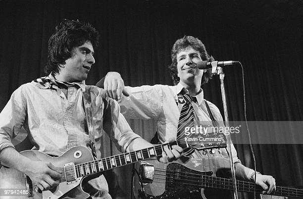 Guitarist Danny Kustow and singer and bassist Tom Robinson of the Tom Robinson Band perform on stage at the Middleton Civic Hall in Manchester...