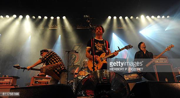 Guitarist Dave Catching singer Jesse Hughes and bassist Matt McJunkins of US rock group Eagles of Death Metal perform on stage during a concert in...