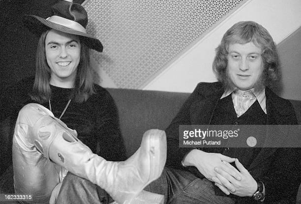 Guitarist Dave Hill and singer Noddy Holder of English glam rock group Slade 1973 Holder is wearing a 'Cum on feel the noize' badge