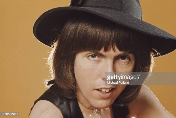 Guitarist Dave Hill of English glam rock group Slade posing wearing a fedora style hat and waistcoat London 17th February 1975
