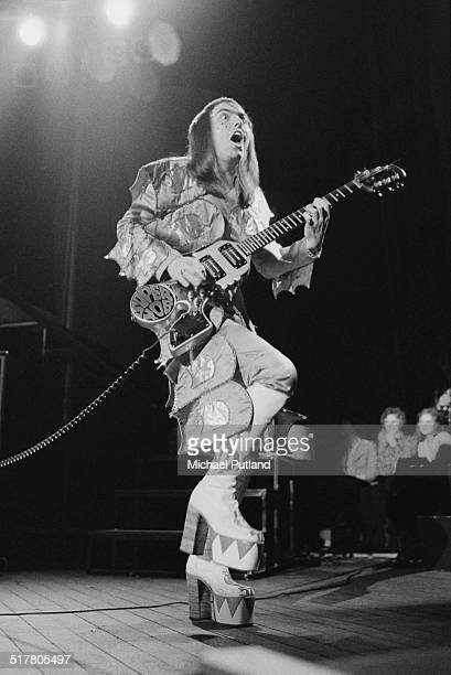Guitarist Dave Hill performing with English glam rock group Slade at Hammersmith Odeon during their 'Crazee Nite Tour' May 1974 He is playing a...