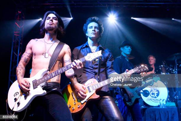 Guitarist Dave Navarro musician Billy Morrison bass guitarist Chris Chaney and drummer Matt Sorum perform at the Official Grand Opening of Galpin...
