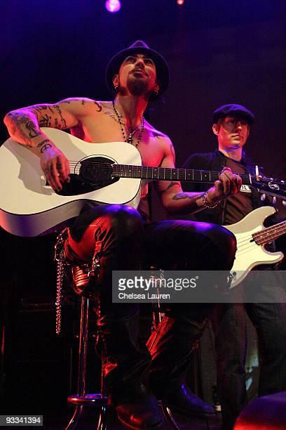 Guitarist Dave Navarro of Jane's Addiction bassist Chris Chaney perform at the Los Angeles Youth Network benefit rock concert at Avalon on November...