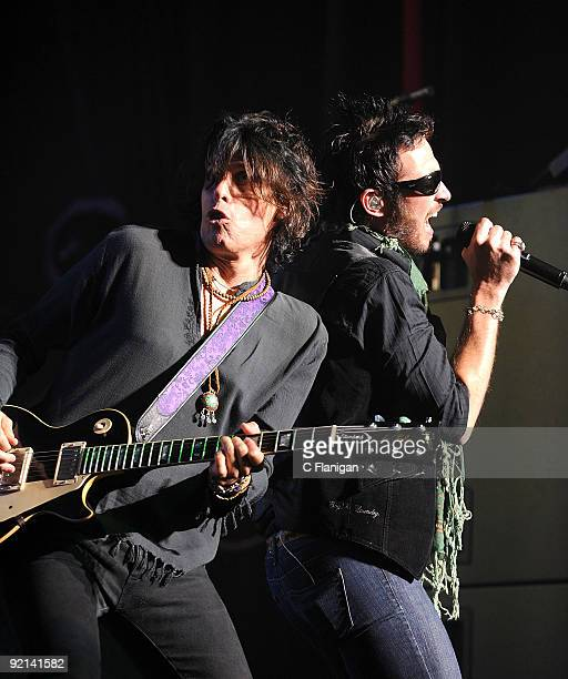 Guitarist Dean DeLeo and Vocalist Scott Weiland of Stone Temple Pilots perform live at The Fox Theatre on October 20 2009 in Oakland California