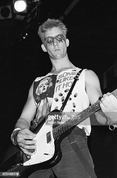 Guitarist Dennis Danell of the punk band Social Distortion performs on stage wearing a Marilyn Monroe tshirt during a concert in Los Angeles
