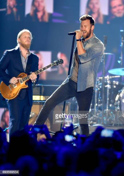 Guitarist Derek Trucks and singersongwriter Charles Kelley performs onstage the 2017 CMT Music Awards at the Music City Center on June 7 2017 in...