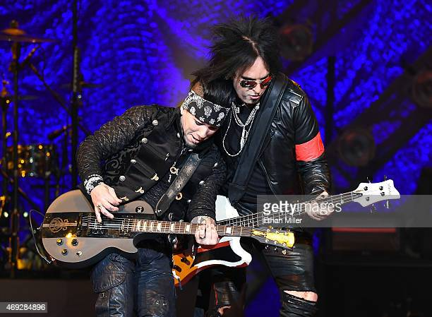 Guitarist Dj Ashba and bassist Nikki Sixx of SixxAM perform at The Joint inside the Hard Rock Hotel Casino on April 10 2015 in Las Vegas Nevada