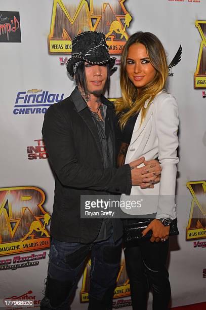 Guitarist Dj Ashba and model Nathalia Henao arrives at the Vegas Rocks Magazine Music Awards 2013 at the Joint inside the Hard Rock Hotel Casino on...