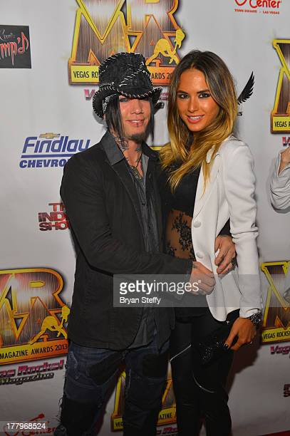 Guitarist Dj Ashba and model Nathalia Henao arrives at the Vegas Rocks Magazine Music Awards 2013 at the Joint inside the Hard Rock Hotel Casino on...
