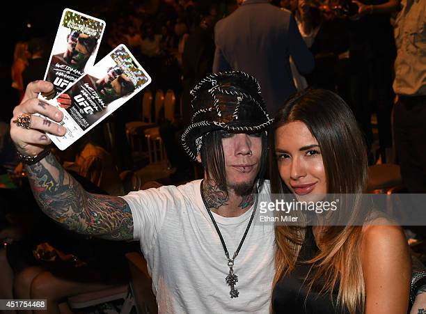 Guitarist Dj Ashba of Guns N Roses and his wife model Nathalia Henao attend the UFC 175 event at the Mandalay Bay Events Center on July 5 2014 in Las...