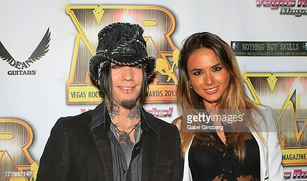Guitarist Dj Ashba of Guns N' Roses and model Nathalia Henao arrive at the 2013 Vegas Rocks magazine music awards at The Joint inside the Hard Rock...