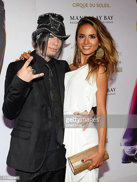 Guitarist Dj Ashba of Guns N' Roses and Nathalia Henao arrive at the world premiere of Michael Jackson ONE by Cirque du Soleil at THEhotel at...