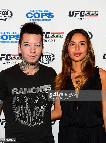 Guitarist Dj Ashba of Guns N' Roses and wife model Nathalia Henao arrive at UFC's advance screening of the Twentieth Century Fox film 'Let's Be Cops'...