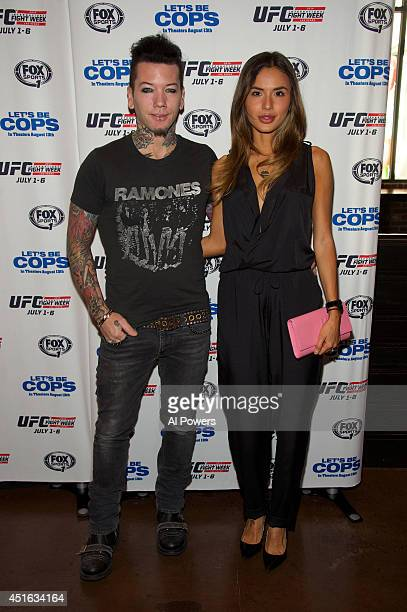 Guitarist Dj Ashba of Guns N' Roses and wife Nathalia Henao arrives at UFC's advance screening of the Twentieth Century Fox film 'Let's Be Cops'...