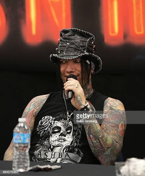 Guitarist Dj Ashba of Guns N' Roses speaks at a meetandgreet at Nellis Air Force Base on May 27 2014 in Las Vegas Nevada