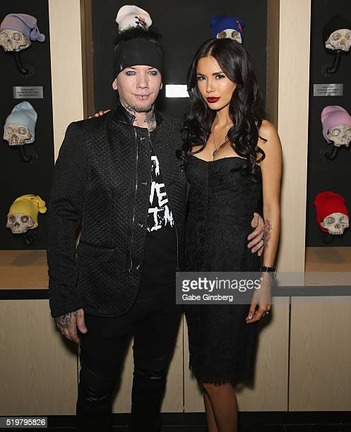 Guitarist Dj Ashba of SixxAM and his wife model Nathalia Henao attend the grand opening of their Ashba Clothing Store at the Stratosphere Casino...
