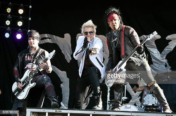 Guitarist DJ Ashba singer James Michael and bassist Nikki Sixx of Sixx AM perform during 2016 Carolina Rebellion at Charlotte Motor Speedway on May 6...