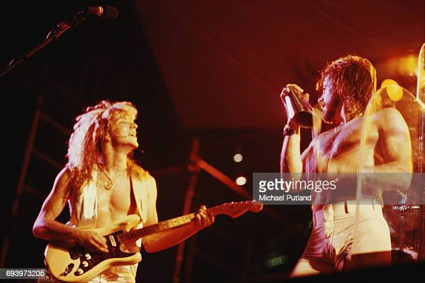 Guitarist Donnie Dacus and singer and trombonist James Pankow performing with American rock group Chicago USA September 1978