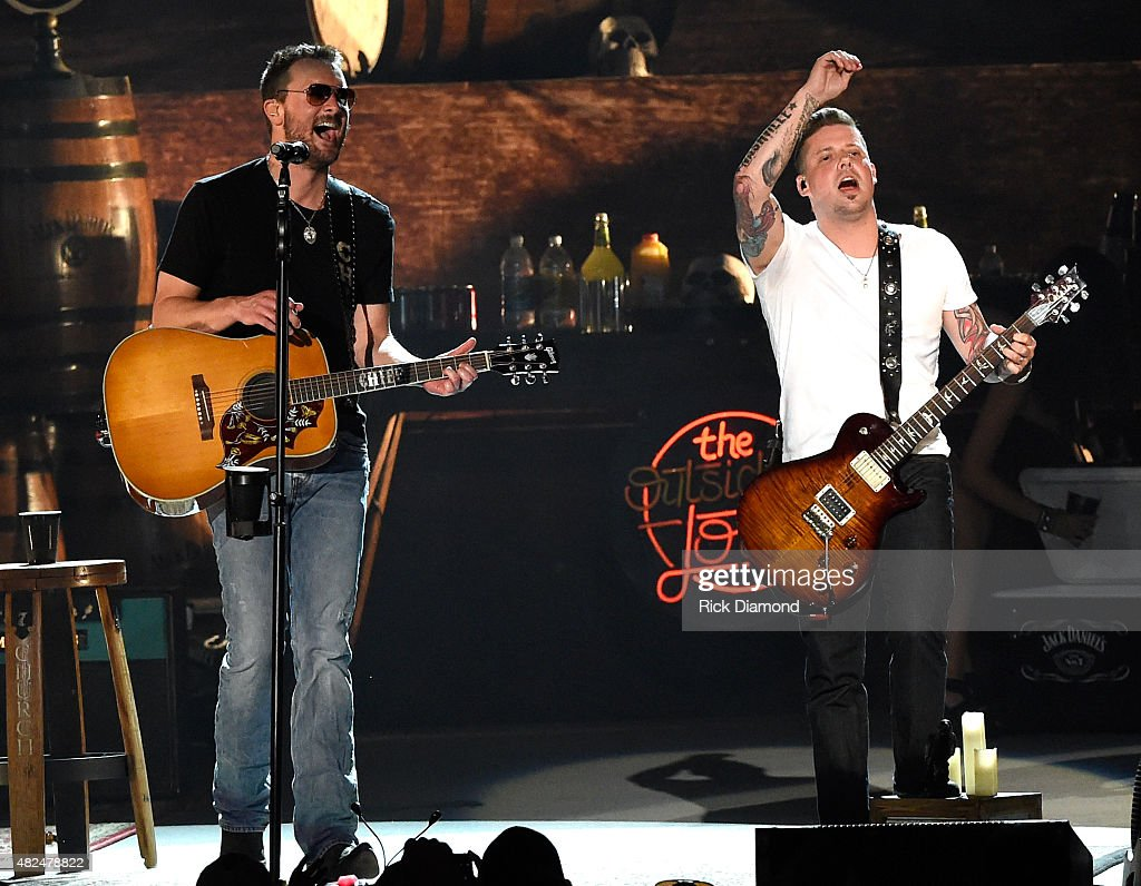Guitarist Driver Williams (White shirt) joins Singer/Songwriter Eric Church for the opening of the new Ascend Amphitheater with the first of two sold out solo shows on July 30, 2015 in Nashville, Tennessee.