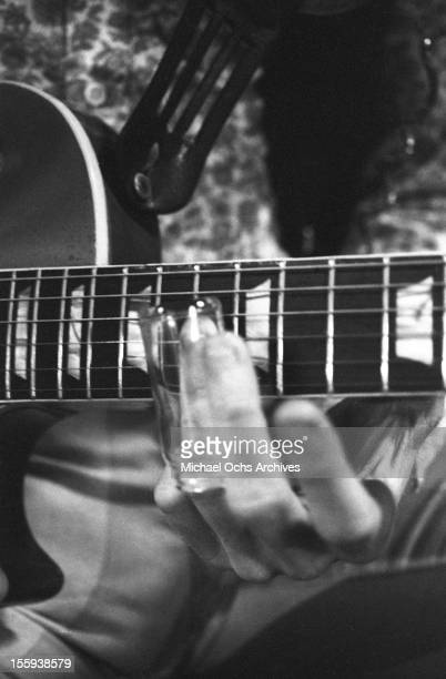 Guitarist Duane Allman of the Southern rock group the 'Allman Brothers' uses a bottle slide on his Gibson Les Paul electric guitar at Muscle Shoals...