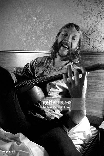 Guitarist Duane Allman uses a steel slide on an acoustic guitar in his hotel room before the Allman Brothers' performance at the Sitar on October 17...