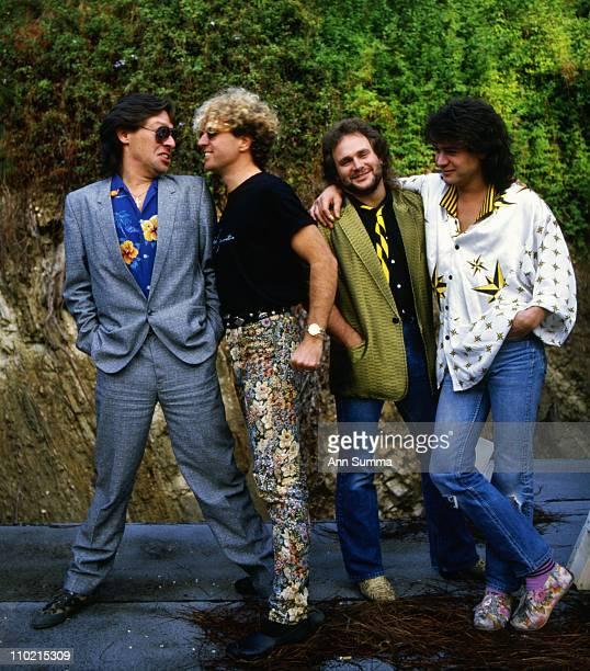 Guitarist Eddie Van Halen bassist Mark Anthony singer Sammy Hagar and drummer Alex Van halen of the rock and roll band Van Halen pose for a photo...