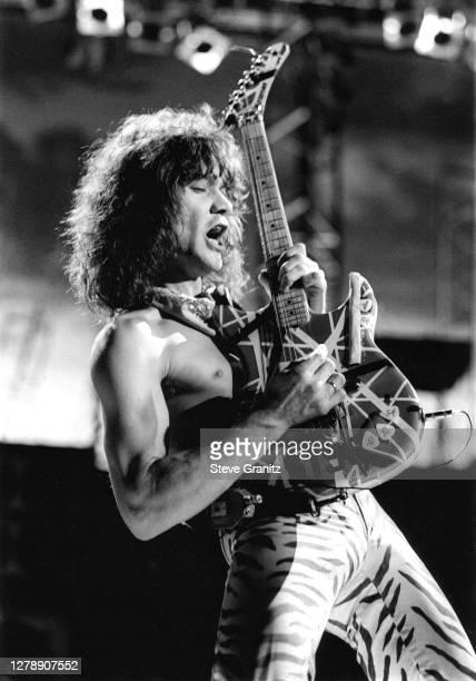 Guitarist Eddie Van Halen of the rock group Van Halen performs at the Forum in May, 1984 in Inglewood, California.