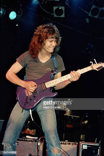 Guitarist Eddie Van Halen plays a rare purple Charvel guitar at a special performance with Allan Holdsworth at the Roxy Theatre on April 29 1982 in...