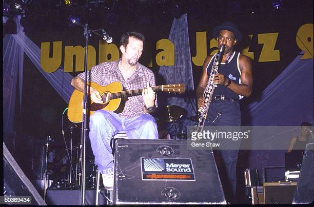 Guitarist Eric Clapton bassist Marcus Miller performing on stage