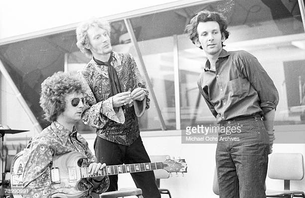 """Guitarist Eric Clapton, drummer Ginger Baker and producer Felix Pappalardi of the rock band """"Cream"""" converse while recording at the """"Strange Brew""""..."""