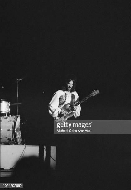 Guitarist Eric Clapton of British rock band Cream in concert, circa 1967.