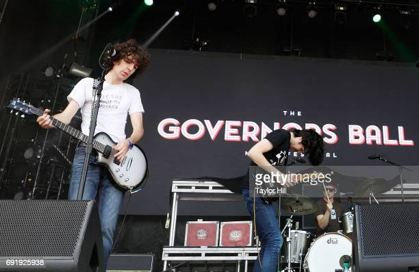 Guitarist Ethan Ives Singer/guitarist Will Toledo and drummer Andrew Katz of Car Seat Headrest perform live onstage during 2017 Governors Ball Music...