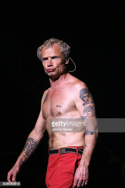 Guitarist Flea of Red Hot Chili Peppers performs at DIRECTV's Super Saturday Night Featuring Red Hot Chili Peppers Cohosted By Mark Cuban's AXS TV at...